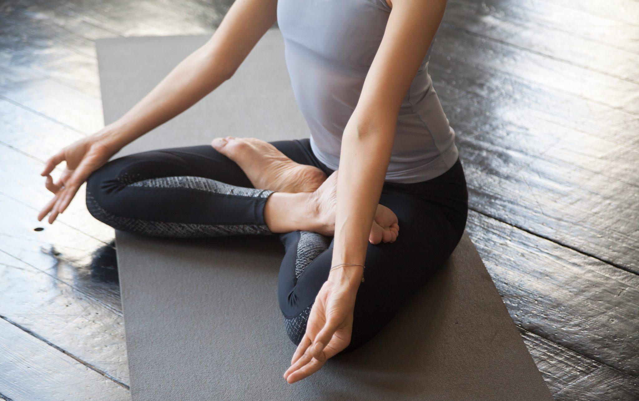 girl meditating on the mat