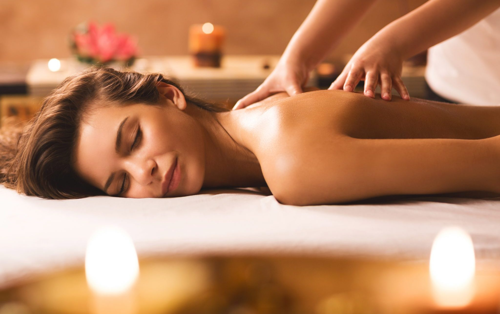 relaxed woman gets a massage